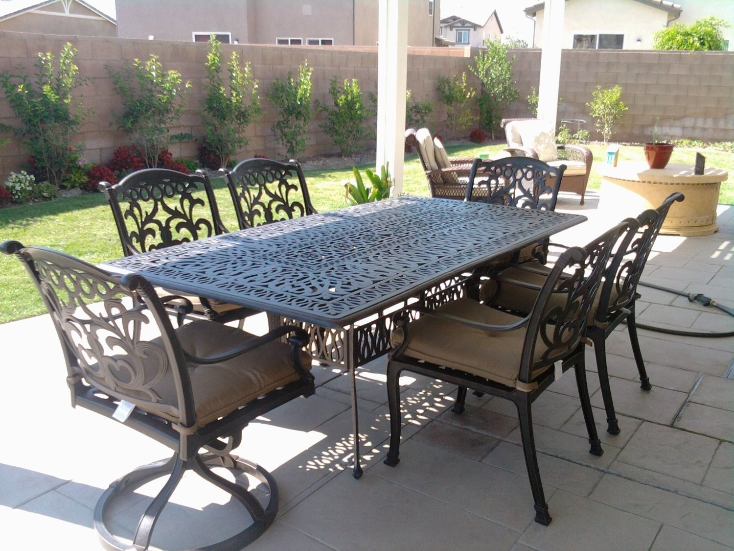 Mandalay cast aluminum powder coated 7pc outdoor patio for Patio furniture table set