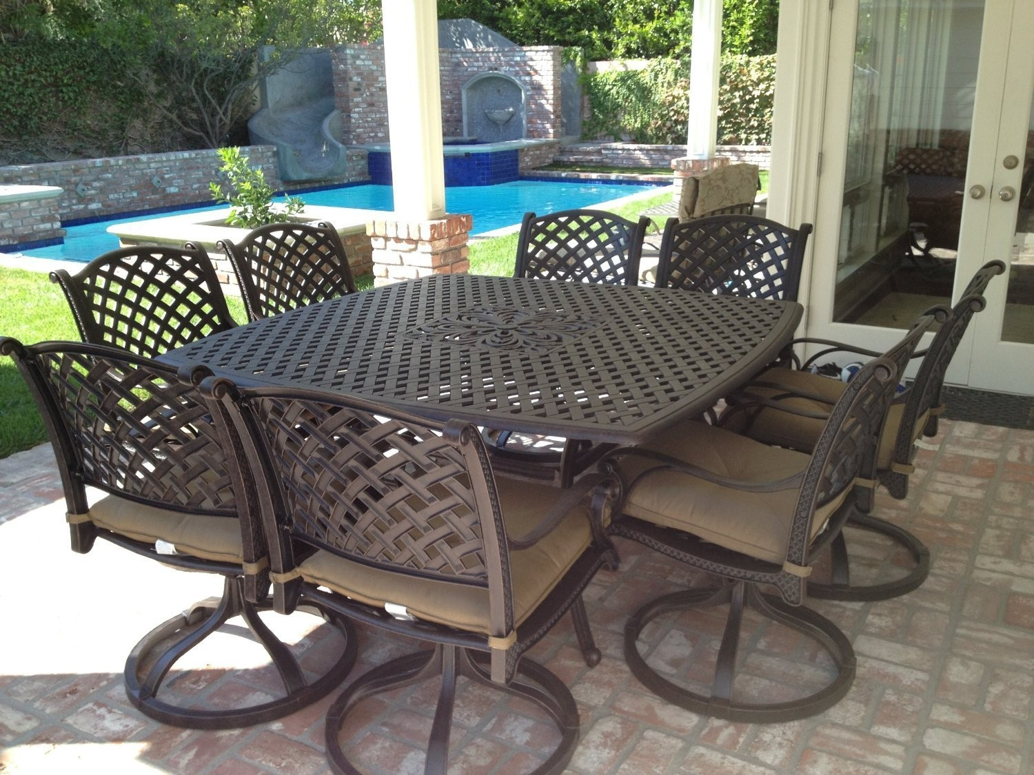 Nassau cast aluminum powder coated 9pc outdoor patio for Patio furniture table set